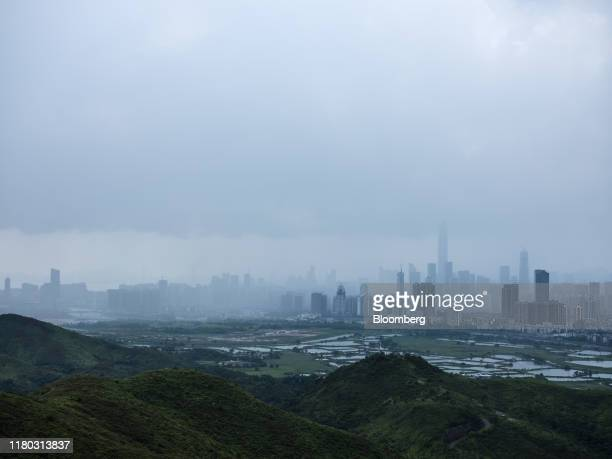 Buildings in Shenzhen shrouded in smog stand beyond farmland and hills in the Ma Tso Lung district of Hong Kong, China, on Monday, Sept. 9, 2019....