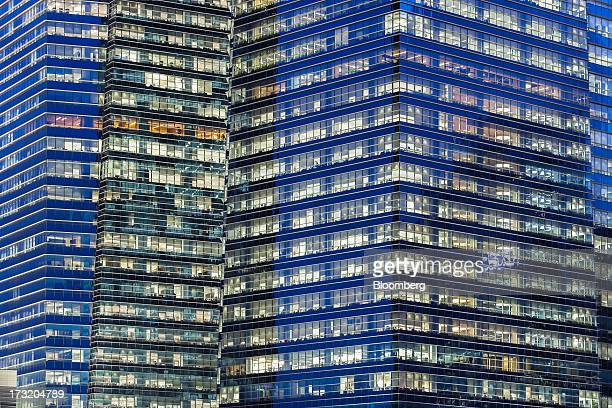 Buildings in the central business district stand illuminated as the sun sets in Singapore on Tuesday July 9 2013 Singapore will release secondquarter...