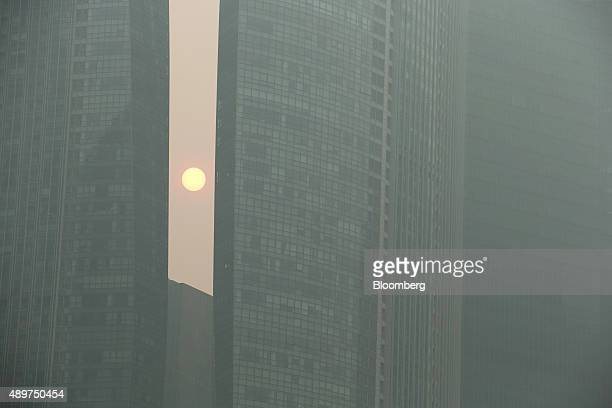 Buildings in the central business district stand shrouded in smog in Singapore, on Thursday, Sept. 24, 2015. The haze from Indonesian forest fires...
