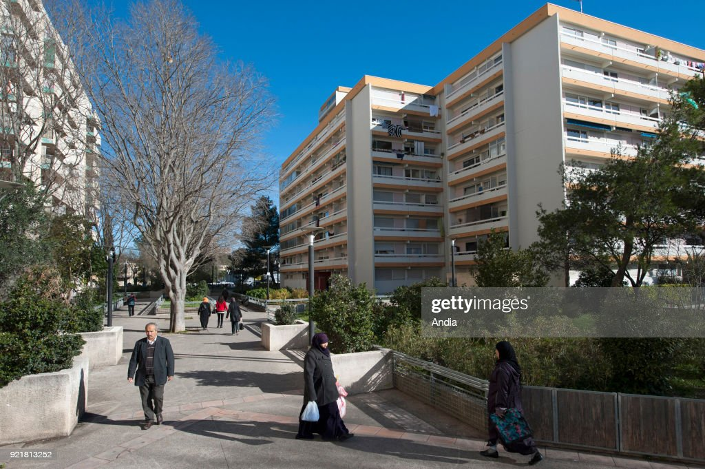 Buildings in the district of La Paillade in Montpellier (south of France). Pedestrians and buildings in the popular district of La Paillade.