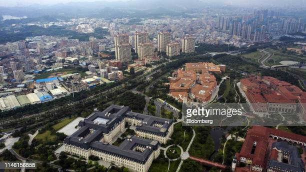 Buildings in the Huawei Technologies Co Ox Horn research and development campus foreground stand among trees in this aerial photograph taken in...