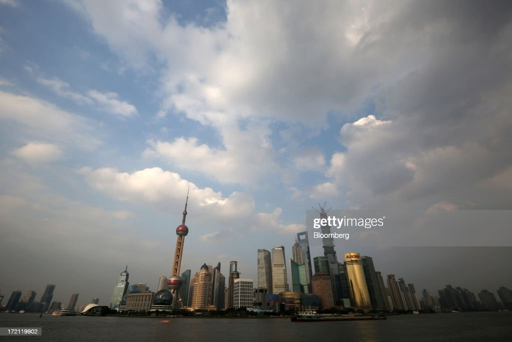 Buildings in the Lujiazui district are seen from the Bund area of Shanghai, China, on Sunday, June 30, 2013. China's President Xi Jinping said officials shouldn't be judged solely on their record in boosting gross domestic product, the latest signal that policy makers are prepared to tolerate slower economic expansion. Photographer: Tomohiro Ohsumi/Bloomberg via Getty Images