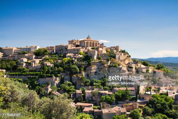 buildings in town against blue sky - provence alpes cote d'azur stock pictures, royalty-free photos & images