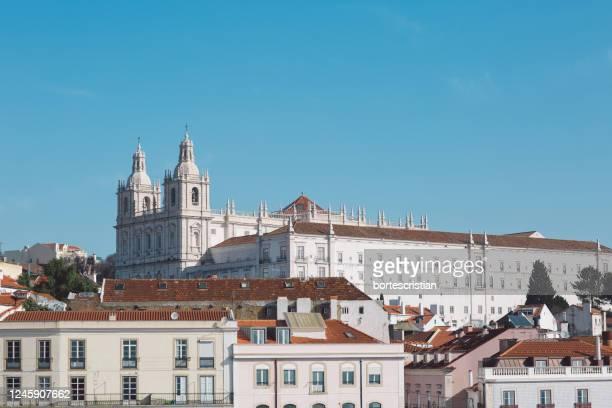 buildings in town against blue sky - bortes stockfoto's en -beelden