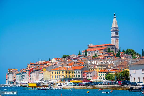 buildings in town against clear blue sky - croatia stock pictures, royalty-free photos & images