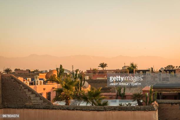 buildings in town against clear sky during sunset - marrakech photos et images de collection