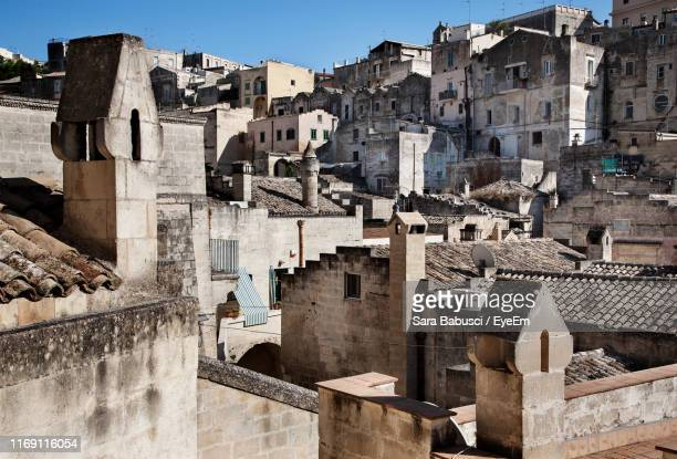 buildings in town against clear sky - basilicata region stock pictures, royalty-free photos & images
