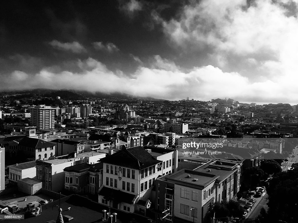 Buildings In Town Against Cloudy Sky : Stock Photo