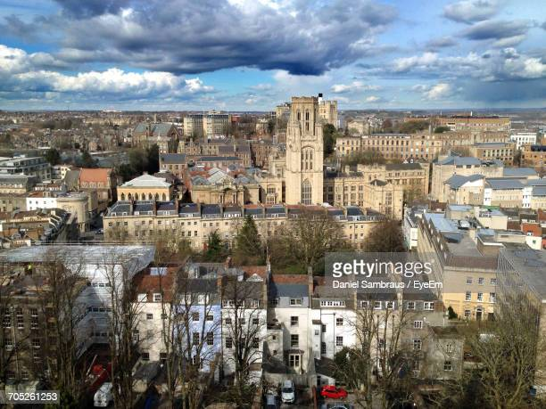 buildings in town against cloudy sky - bristol stock photos and pictures