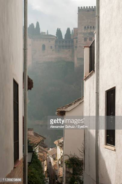 buildings in town against sky - granada spain landmark stock pictures, royalty-free photos & images