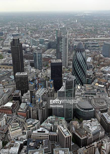 Buildings including the Tower 42 and the Swiss Re building also known as the 'Gherkin' sit in the city's financial district in London UK on Wednesday...