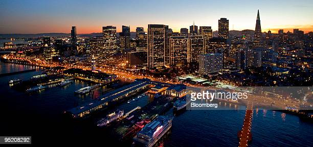 Buildings including the Transamerica Pyramid at right stand along the skyline of San Francisco California US as seen in this aerial photo taken on...