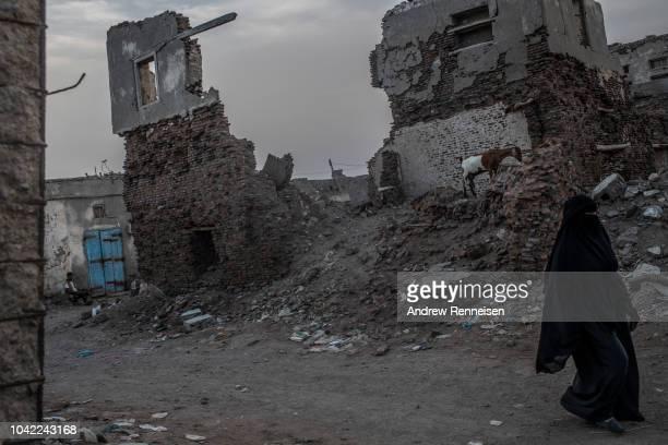 Buildings lay in ruins on September 22, 2018 in Mocha, Yemen. The city was retaken from Houthi rebels in early 2017, part of Yemen's Saudi-led...