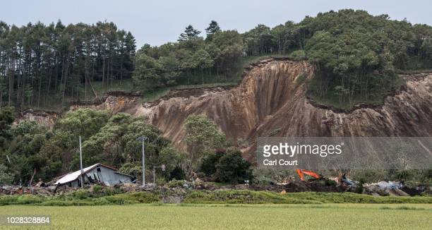 Buildings lie in ruins after being hit by a landslide caused by an earthquake on September 7 2018 in Atsuma near Sapporo Japan Sixteen people are now...