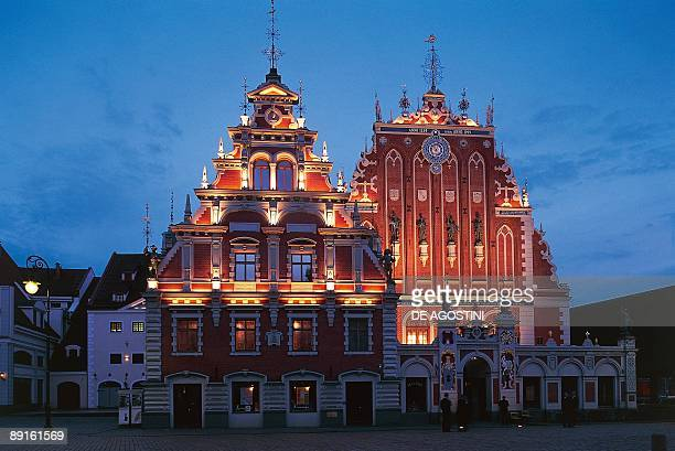 Buildings lit up at night House of Blackheads Riga Latvia