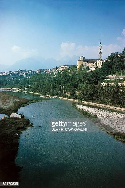 Buildings near a river Piave River Belluno Veneto Italy