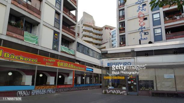 buildings near kottbusser tor in the district of kreuzberg in berlin, germany - berlin stock pictures, royalty-free photos & images