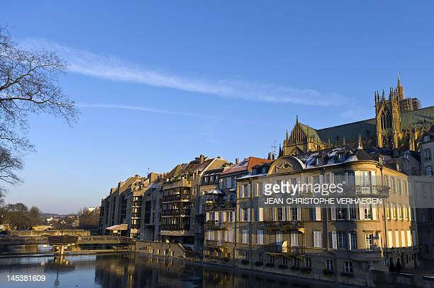 Buildings near the river Moselle and Saint Etienne Cathedral are pictured on February 6 2012 in Metz eastern France AFP PHOTO / JEANCHRISTOPHE...