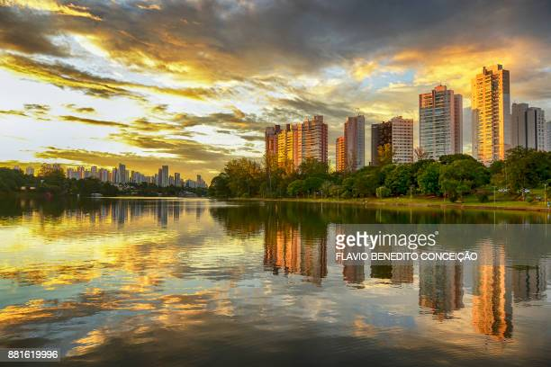 buildings of apartments on the banks of lake igapo with the sunset and red clouds - londrina stock pictures, royalty-free photos & images