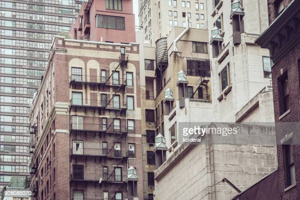 buildings of midtown manhattan - midtown manhattan stock pictures, royalty-free photos & images
