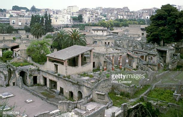 Buildings of the Roman town of Herculaneum: with houses of the modern town of Ercolano above, Italy.