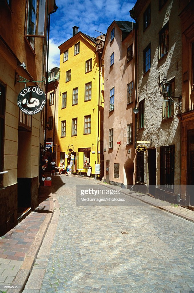 Buildings on both sides of a street, Gamla Stan, Stockholm, Sweden : Stock Photo