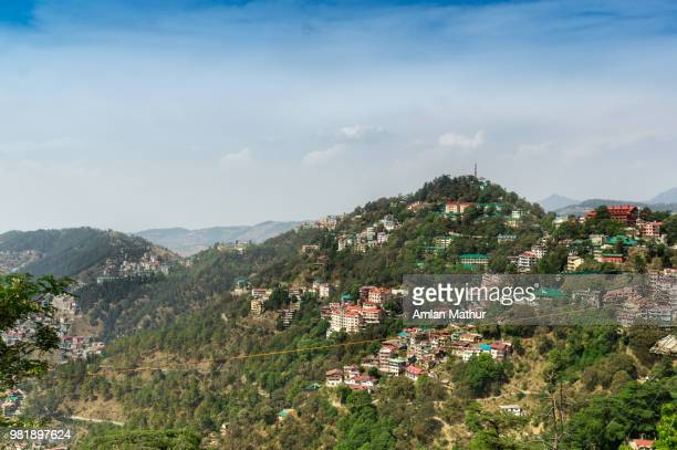 buildings on mountain in the indian city of shimla - westbengalen stock-fotos und bilder