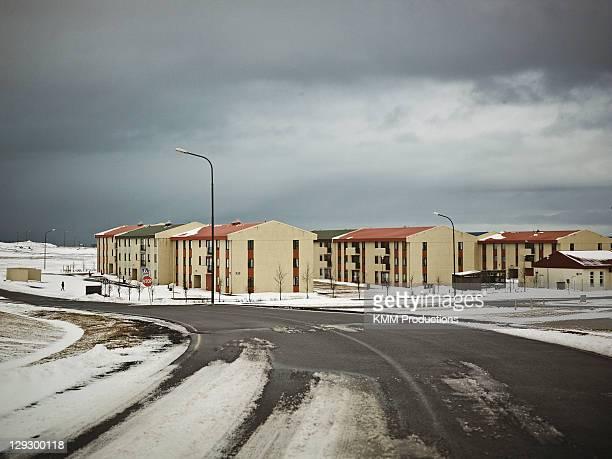 Buildings on snowy suburban street