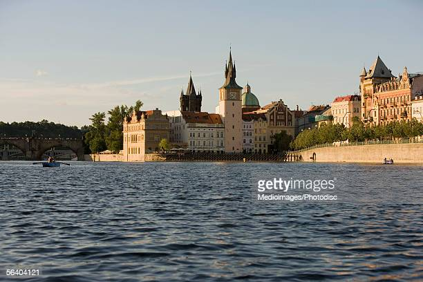 buildings on the banks of a river, vltava river, prague, czech republic - clock tower stock pictures, royalty-free photos & images