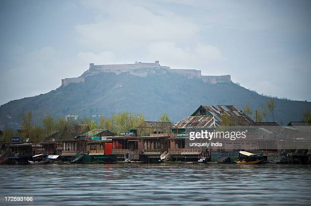 buildings on the banks of the jhelum river, srinagar, jammu and kashmir, india - kashmir valley stock photos and pictures