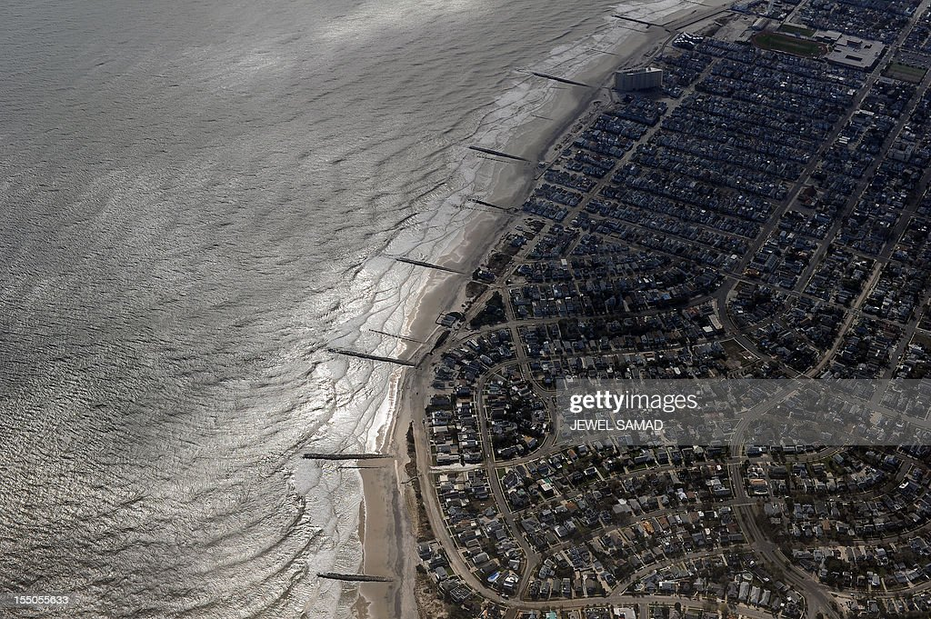 Buildings on the shoreline are pictured from onboard Air Force One as it prepares to land in Atlantic City, New Jersey, on October 31, 2012 with US President Barack Obama to visit areas hardest hit by the unprecedented cyclone Sandy. Americans sifted through the wreckage of superstorm Sandy on Wednesday as millions remained without power. The storm carved a trail of devastation across New York City and New Jersey, killing dozens of people in several states, swamping miles of coastline, and throwing the tied-up White House race into disarray just days before the vote. AFP PHOTO/Jewel Samad