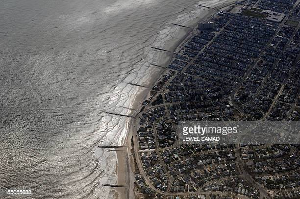 Buildings on the shoreline are pictured from onboard Air Force One as it prepares to land in Atlantic City New Jersey on October 31 2012 with US...