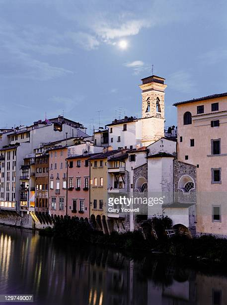 buildings reflected in river arno at dusk - yeowell stock pictures, royalty-free photos & images