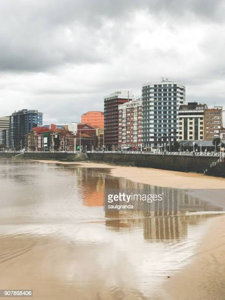 Buildings reflected on the beach
