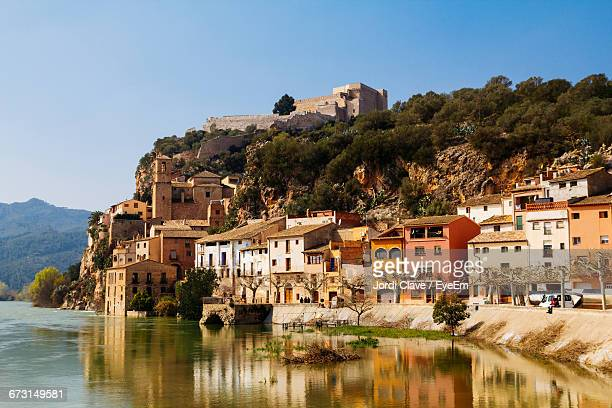 buildings reflecting on ebro river - ebro river stock photos and pictures