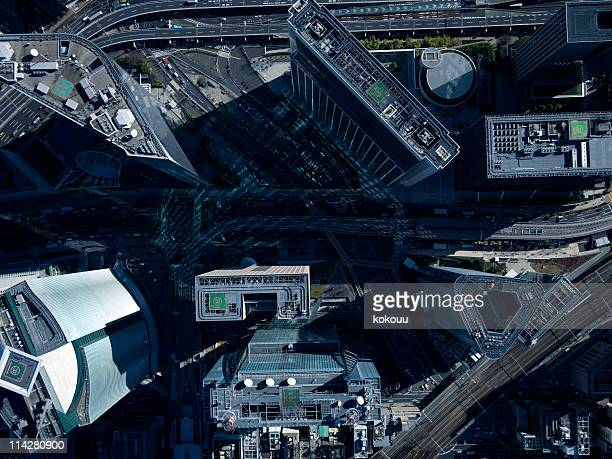 buildings seen from above. - overhead view of traffic on city street tokyo japan stock photos and pictures