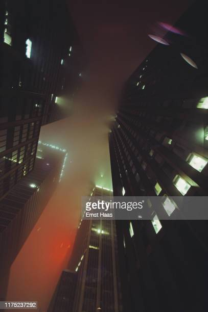 Buildings seen from below on a foggy night in New York City US 1981