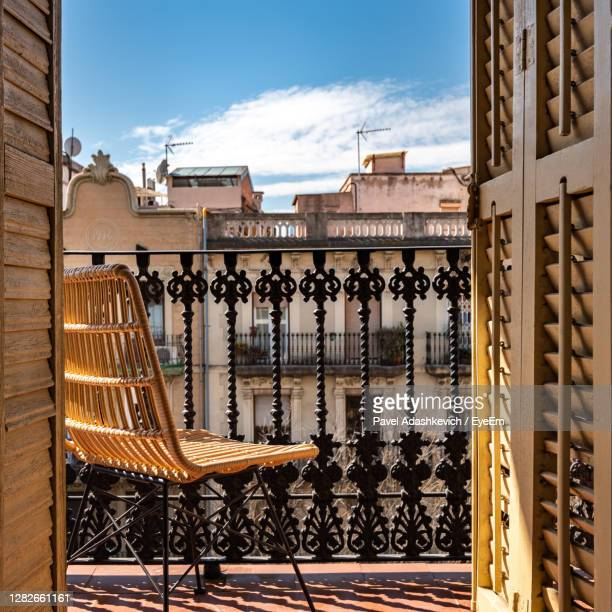 buildings seen through balcony - hostel stock pictures, royalty-free photos & images