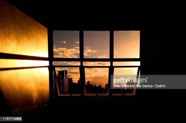 buildings seen through window in darkroom - photographed through window stock pictures, royalty-free photos & images