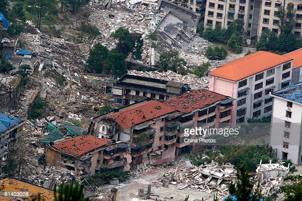 Buildings sit destroyed June 4 2008 in Beichuan County of Sichuan Province China More than 69000 people are now known to have died in the quake and...