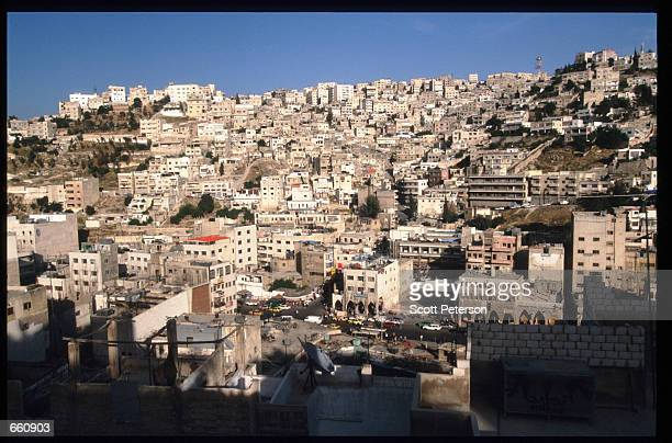 Buildings sit packed together on a hillside May 17 1998 in Amman Jordan Still a teenager when crowned in 1952 King Hussein has led the young Arab...