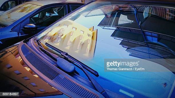 buildings sky reflected in parked car windshield - windshield stock pictures, royalty-free photos & images