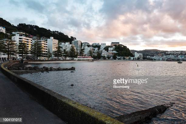 Buildings stand along a waterfront in Wellington New Zealand on Wednesday July 18 2018 New Zealand inflation picked up in the second quarter amid...