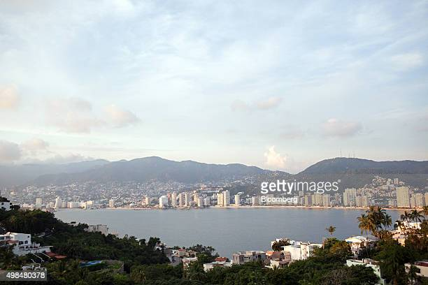 Buildings stand along the beach in Acapulco Mexico on Wednesday Nov 18 2015 Acapulco needs to shed the perception that it is a 'place of violence'...