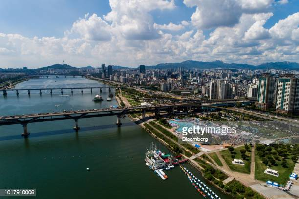 People bathe in a swimming pool at Ttukseom Hangang Park in this aerial photograph taken in Seoul South Korea on Saturday Aug 11 2018 South Korea...