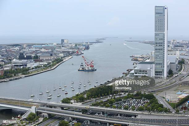 Buildings stand along the Shinano River in Niigata Niigata Prefecture Japan on Wednesday Aug 3 2016 In attempting to hit a 2 percent annual inflation...
