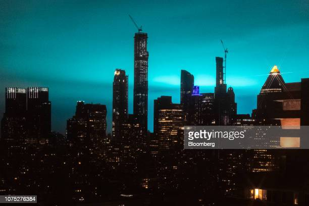 Buildings stand as the night sky is illuminated by blue light in New York US on Thursday Dec 27 2018 The New York Police Department is investigating...
