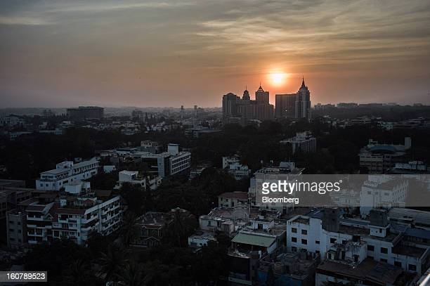 Buildings stand at sunset in Bangalore India on Monday Feb 4 2013 India's monetary authority predicted that the economy will expand 55 percent in the...