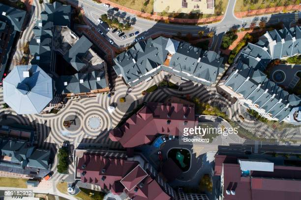 Buildings stand at the Alpensia Resort in this aerial photograph taken above Pyeongchang Gangwon South Korea on Friday Oct 20 2017 With less than 100...