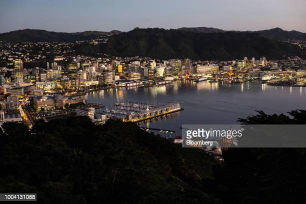 Buildings stand illuminated at dawn in Wellington New Zealand on Wednesday July 18 2018 New Zealand inflation picked up in the second quarter amid...